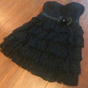 Black lacy strapless dress.